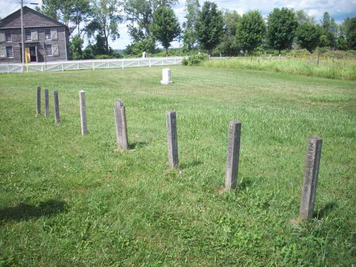 All the victims, excepting Mary Cole, were buried in this graveyard. The grave markers are unusual wooden posts. (my photo)